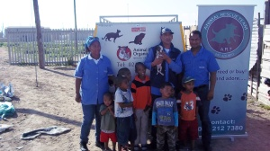 ARO staff members teaching the children of Blikkiesdorp responsible pet ownership